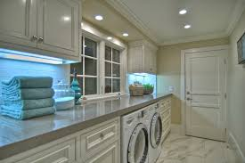 laundry room tile ideas laundry room beach style with crown molding white cabinets beach style laundry room