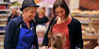 customer assistant   tesco careerscolleague in uniform assisting a customer and her daughter