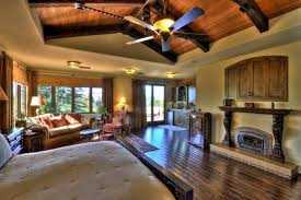 big master bedrooms couch bedroom fireplace: an enormous master bedroom suite with tons of windows and a vaulted ceiling near the