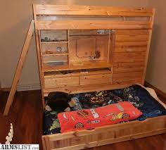 very high quality solid pine bunk bed two twin beds with built in pull out desk built in dresser and really cool hiding fort play area hidden in the bunk bed dresser desk