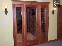 vigilant mahogany full glass wine cellar door with two sidelights fluted casing and crown molding mahogany wine cellars traditional wine cellar