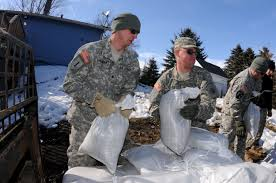 u s department of defense photo essay u s army spc tim sybrant left passes sandbags to pfc scott ness
