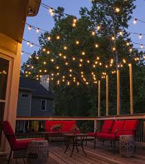 hang patio lights across a backyard deck outdoor living area or patio guide for awesome modern landscape lighting design ideas bringing