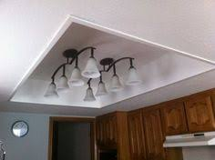kitchen fluorescent lighting. tired of your fluorescent light box remove old framed panel with lights finish off the and add new fixtures kitchen lighting