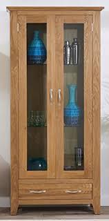 camberley oak glass display cabinet includes three glass shelves with light oak finish 2 door camberley oak 2 door