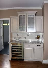 cool kitchen with white cabinets and lighting ideas this kitchen remodel in cleveland included new kraftmaid cabinetry in a muchroom finish tile backsplash cabinet and lighting