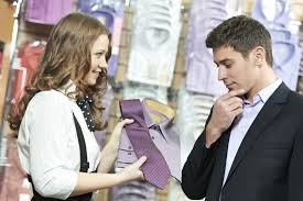 suggestive selling in retail how to increase add on s out young man choosing shirt and necktie during apparel shopping at clothing store