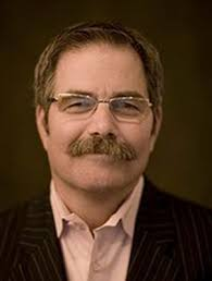 "Here's a photo of Paul David Tripp. I almost have to say, ""What is that thing on his lip?"" but Dave Wilson assures us it's a mustache. - Tripp-photo2"