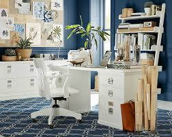 design decorate blue wall blue floor and white motif white wooden table white wooden chairs drawing paper macbook pro white wooden cabinets white wooden blue brown home office
