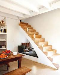 living room with bed:  living room with black sofa and white lamp interiorinteresting stair space with bed under the stairs plus wall shelves and furniture feat white paint