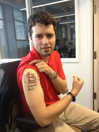 ben chambers is probably the biggest if not simply the most epidermically dedicated cardinals fan in the office ben office fan