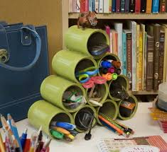 stack recycled cans to organize office supplies awesome organize office