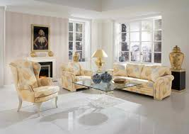 cream couch living room ideas: cream sofa with glass table on the white floor placed f wall room decorating living