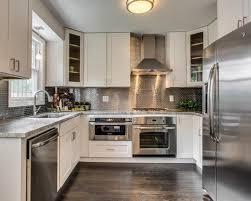 kitchen backsplash stainless steel tiles: saveemail bfbf  w h b p transitional kitchen
