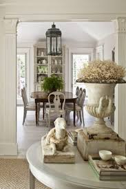 dining room khaki tone: i could see a large urn pottery planter that has some interest on the floor in the entry maybe something that can be an umbrella holder not on table