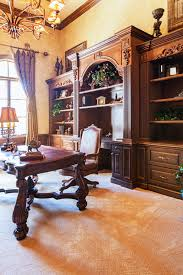 stunning modern executive desk designer bedroom chairs: this home office is a truly ornate traditional affair with carved wood leather