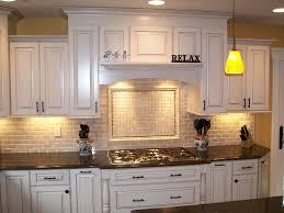 small favorite dream home kitchen interior designs with antique cream kitchen cabinets combinated black ceramic tile backsplash and impressive small kitchen cabinet lighting backsplash home design