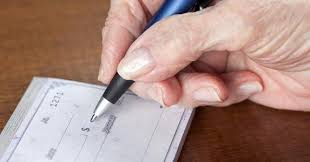 Senior writing check