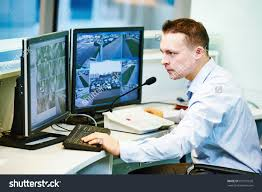 security guard officer watching video monitoring stock photo security guard officer watching video monitoring surveillance security system