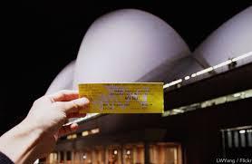 Sydney Opera House Tickets ⋆ SydneyCloseup comHand holding Sydney opera house tickets in front of the opera house at night