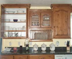 painted kitchen cabinets vintage cream: vintage wooden kitchen unit with glass kitchen cabinet plus black granite countertop also cream wall paint
