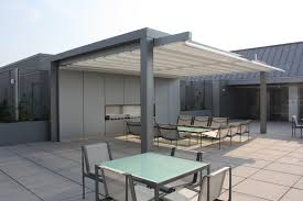 aluminium patio cover surrey: this is not your ordinary retractable awningit is a retractable water proof not water resistant patio cover system it is retractableawning