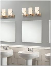 bathroom cute bathroom design with white pedestal sink and rectangular mirror under triple vanity lights bathroom amazing amazing amazing bathroom lighting