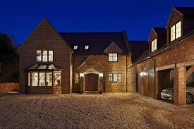 within the cotswold stone faade there is a full oak post and beam frame build home cotswold