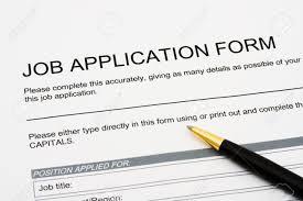a job application jobs sitting a pen applying for a job a job application jobs sitting a pen applying for a job stock photo