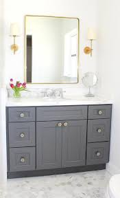 ideas traditional bathroom pinterest traditional bathroom featuring gray shaker style cabinetry marble hexa