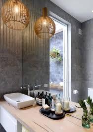 pendant modern bathroom lighting with small candles on single sink bathroom vanity under large mirror bathroom vanity pendant