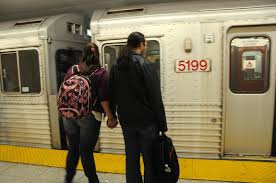 photo essay commute krysten mccumber a young couple holds hands as the subway approaches royal york station photo by