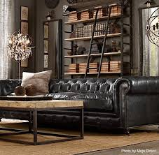 its the sophisticated man cave with a tall bookshelf and a black leather couch ready black leather sofa