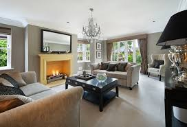 expansive living room in neutral tones of grey and white punctuated by soft yellow mantle beautiful living room pillar