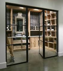 rustic wood finishes in this otherwise modern wine cellar design by barbara colvin box version modern wine cellar