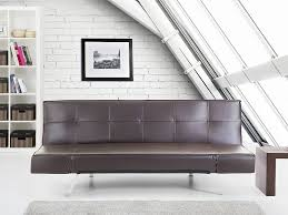 An elegant reclining brown <b>sofa bed</b> made from <b>synthetic</b> material ...