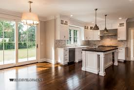kitchen design cabinets traditional light:  kitchen cabinets traditional kitchen with restoration hardware harmon pendant dura supreme cabinetry arcadia panel inset