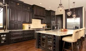 countertops dark wood kitchen islands table: dark brown wooden kitchen island combined with storage with glass door also shelves combined with cream