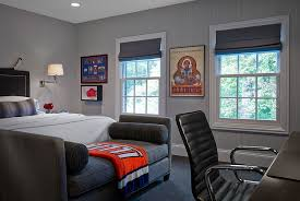 view in gallery transitional masculine bedroom showcases a plush way to decorate the foot of the bed bedroom male bedroom ideas