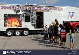 goodfellow air force base stock photos goodfellow air force base children line up to enter a fire safety house outside the school age program center at