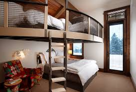 mountain chic mountain style loft style bedroom photo in other with white walls and carpet bed with office underneath