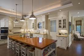 kitchen traditional kitchen idea in new york with wood countertops shaker cabinets white cabinets and stainless black kitchen island lighting