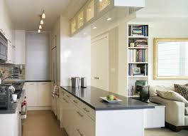 small space kitchen ideas: small lighting in galley kitchen design with white cabinets and calm countertops color