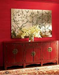 flower on top of asian closet with painting on top asian inspired furniture