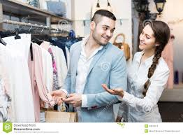 shop assistant helping customer at clothes shop stock images customer consulting shop assistant royalty stock photo