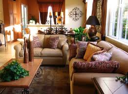 a living room with southwestern flair and fantastic patterned throw pillows on the beige sofa and beautiful small livingroom