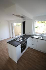 kitchen flush white gloss white kitchen peninsular units with flush ceiling extractor in d