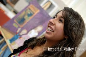 Jasmin Atiles Junior at Imperial High, stands in front of her panting as she ... - 29560227E