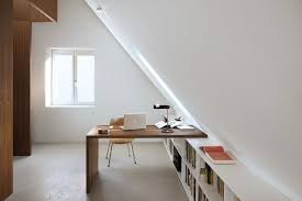 bright attic with interesting desk for an office space attic office ideas