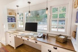 iredell st elegant home office photo in los angeles with a built in desk and white built home office